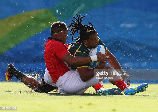 Rosko Specman of South Africa is tackled by Dan Norton of Great Britain during the Men's Rugby Sevens semi final match between Great Britain and...