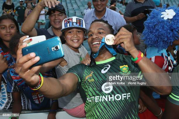 Rosko Specman of South Africa poses for a selfie with the crowd as he celebrates winning the Cup Final match between England and South Africa in the...