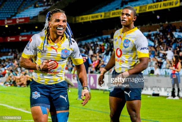 Rosko Specman of the Bulls celebrates a try during the Super Rugby match between Vodacom Bulls and Highlanders at Loftus Versfeld Stadium on March 07...
