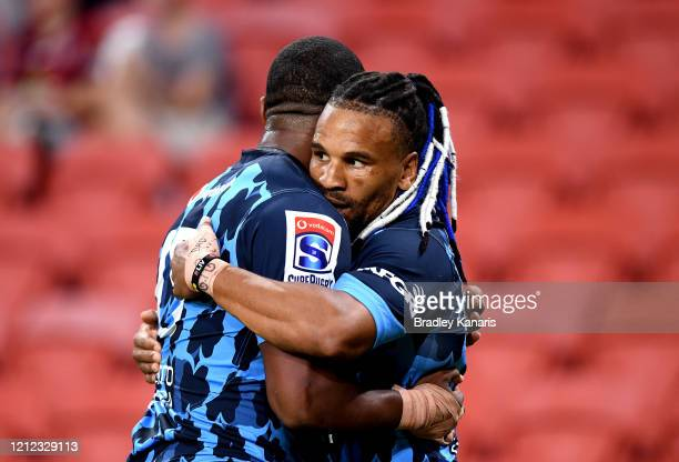 Rosko Specman of the Bulls celebrates with team mate Franco Naude after scoring a try during the round seven Super Rugby match between the Reds and...