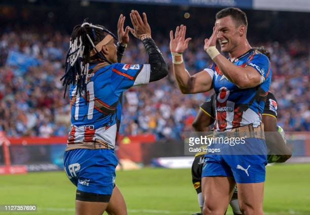 Rosko Specman of the Vodacom Bulls celebrates with team mate Jessie Kriel of the Vodacom Bulls after scoring his third try during the Super Rugby...