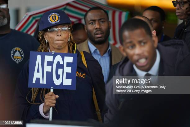 Roslyn Austin Stewart listens as the American Federation of Government Employees the union that represents TSA officers holds a press conference in...