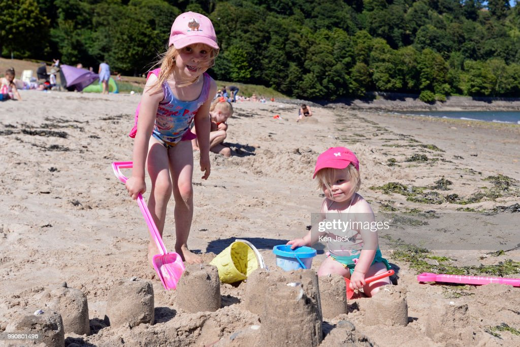 Roslyn Montague (2) and her sister Susannah (4) from Lauder build a sand castle on Silver Sands beach at the start of the Scottish school holidays as the heatwave continues, on July 3, 2018 in Aberdour, Scotland. (Photo by Ken Jack - Corbis/Corbis via Getty Images) Roslyn Montague, SUsannah Montague