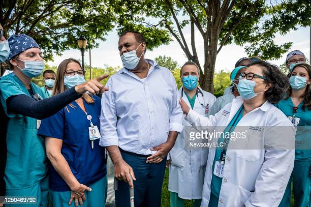 Tony Thomas, a New Hyde Park, New York registered nurse reunites with the medical team at St. Francis Hospital in Roslyn, New York, that helped him...