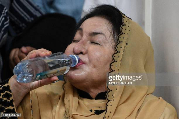 Rosmah Mansor wife of Malaysia's former prime minister Najib Razak drinks water before her husband took part in a sumpah laknat a rare prayer calling...