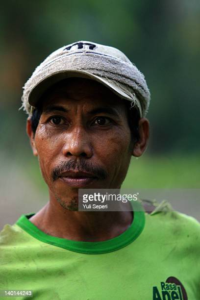 Rosman Farmer on the oil palm plantations on February 28, 2012 in Bintan Island, Indonesia. Indonesian palm oil producers have been hit by the...