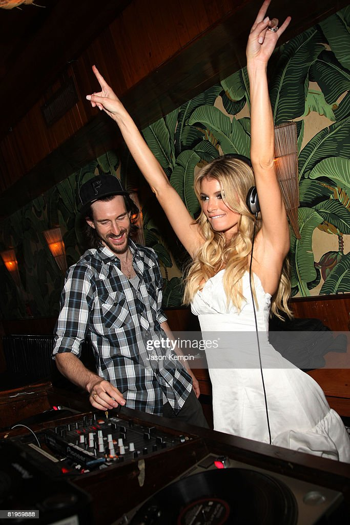 DJ Ross 1 and model Marisa Miller attend an Evening Celebrating Vans by Marisa Miller at The Cabanas at the Maritime Hotel on July 16, 2008 in New York City.
