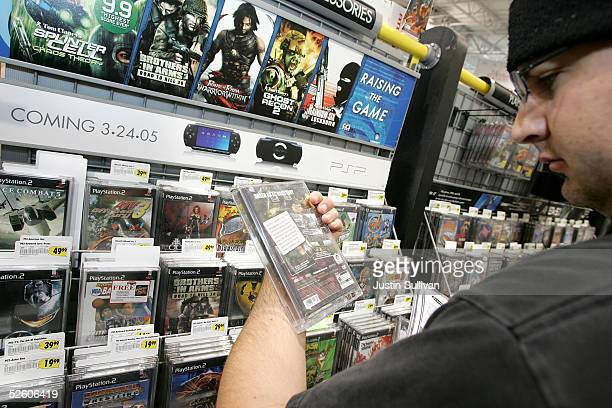 Ross Atherton shops for video games at a Best Buy store April 8 2005 in San Francisco California Nielsen Entertainment said on Thursday that men...