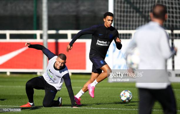 Ross Barkley and Trent AlexanderArnold in action during an England Training Session at St Georges Park on October 9 2018 in BurtonuponTrent England