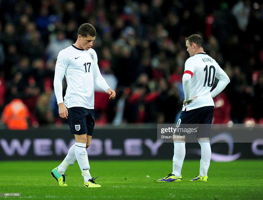 Ross Barkley and Wayne Rooney (10) of England look dejected as Alexis Sanchez of Chile (not pictured) scores their second goal during the international friendly match between England and Chile at Wembley Stadium on November 15, 2013 in London, England.