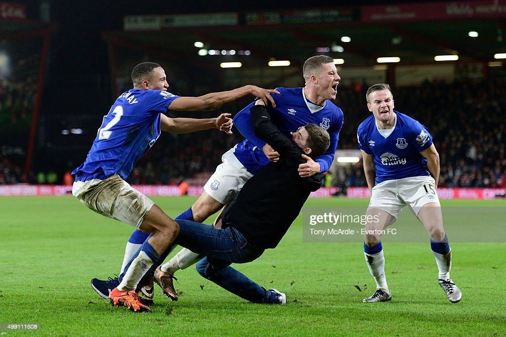 Ross Barkley celebrates his goal with team mates Brendan Galloway (L) Tom Cleverley (R) and an over exuberant fan during the Barclays Premier League match between A.F.C. Bournemouth and Everton at Vitality Stadium on November 28, 2015 in Bournemouth, England.