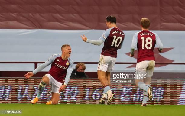 Ross Barkley of Aston Villa celebrates with Jack Grealish of Aston Villa and Matt Targett of Aston Villa after he scores his sides 5th goal during...