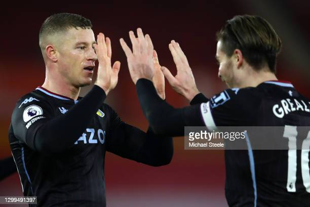 Ross Barkley of Aston Villa celebrates with team mate Jack Grealish after scoring their side's first goal during the Premier League match between...