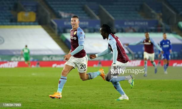 Ross Barkley of Aston Villa celebrates with teammate Bertrand Traore after scoring his team's first goal during the Premier League match between...