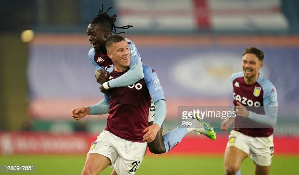 Ross Barkley of Aston Villa celebrates with teammates Bertrand Traore and Matty Cash after scoring his team's first goal during the Premier League...
