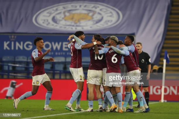 Ross Barkley of Aston Villa is mobbed by teammates after scoring a goal to make it 01 during the Premier League match between Leicester City and...