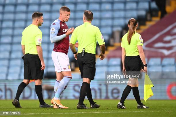 Ross Barkley of Aston Villa speaks to match referee Paul Tierney following the Premier League match between Aston Villa and Leeds United at Villa...