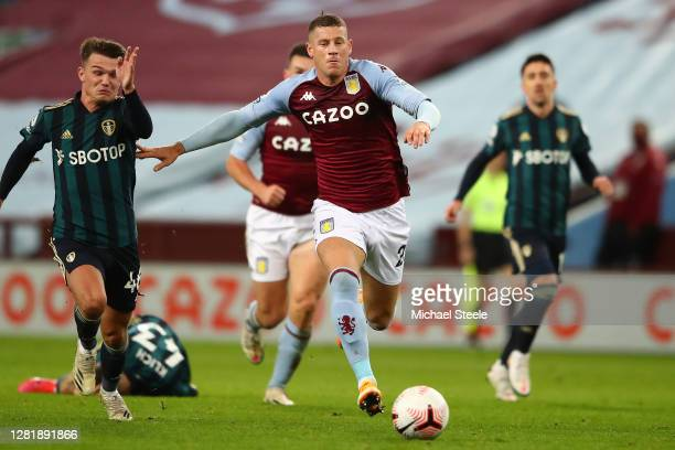 Ross Barkley of Aston Villa tracked by Jamie Shackleton of Leeds United during the Premier League match between Aston Villa and Leeds United at Villa...
