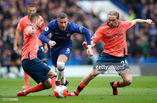 Ross Barkley of Chelsea battles for possession with Gylfi Sigurdsson Tom Davies of Everton during the Premier League match between Chelsea FC and...