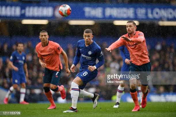 Ross Barkley of Chelsea battles for possession with Gylfi Sigurdsson of Everton and Richarlison of Everton during the Premier League match between...