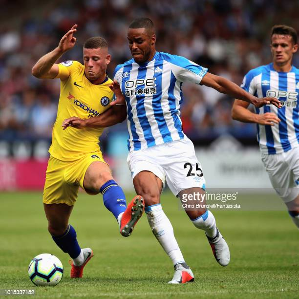 Ross Barkley of Chelsea battles for the ball with Mathias Zanka of Huddersfield Tommy Smith of Huddersfield Town during the Premier League match...