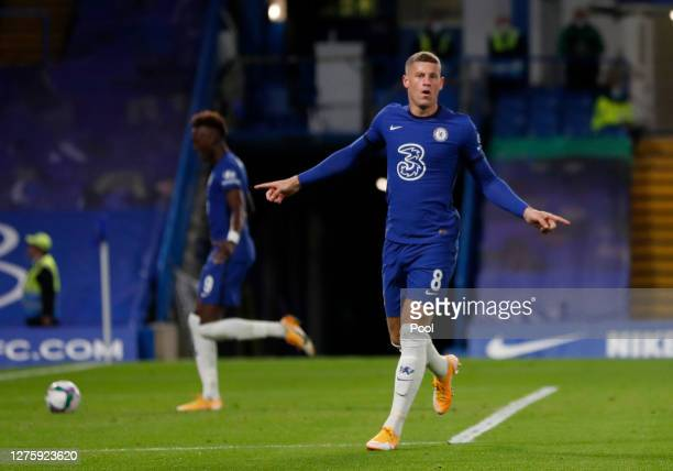 Ross Barkley of Chelsea celebrates after scoring his sides third goal during the Carabao Cup third round match between Chelsea and Barnsley at...
