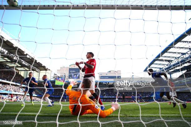 Ross Barkley of Chelsea celebrates after scoring his team's second goal as Victor Lindelof of Manchester United and David De Gea of Manchester United...