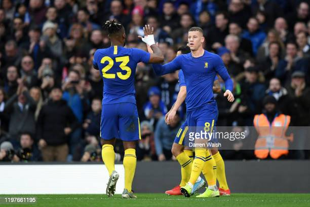 Ross Barkley of Chelsea celebrates after scoring his team's second goal with teammate Michy Batshuayi during the FA Cup Third Round match between...