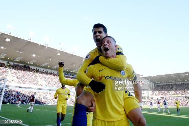 Ross Barkley of Chelsea celebrates with Alvaro Morata after scoring his teams second goal during the Premier League match between Burnley FC and...