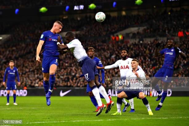 Ross Barkley of Chelsea heads the ball ahead of Moussa Sissoko of Tottenham Hotspur during the Carabao Cup Semi Final First Leg between Tottenham...