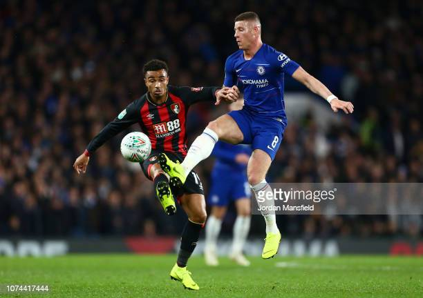 Ross Barkley of Chelsea is challenged by Junior Stanislas of AFC Bournemouth during the Carabao Cup Quarter Final match between Chelsea and AFC...
