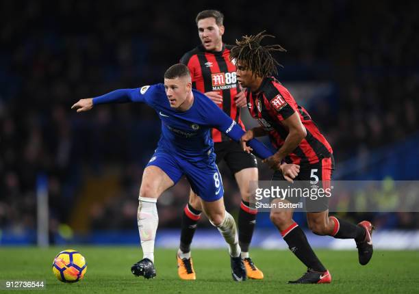 Ross Barkley of Chelsea is challenged by Nathan Ake of AFC Bournemouth during the Premier League match between Chelsea and AFC Bournemouth at...