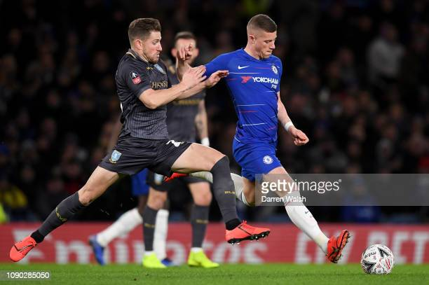 Ross Barkley of Chelsea is challenged by Sam Hutchinson of Sheffield Wednesday during the FA Cup Fourth Round match between Chelsea and Sheffield...