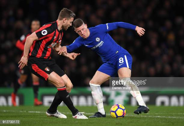 Ross Barkley of Chelsea is challenged by Simon Francis of AFC Bournemouth during the Premier League match between Chelsea and AFC Bournemouth at...