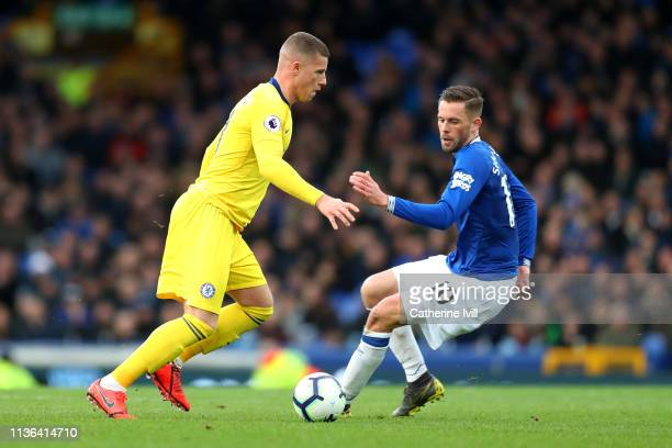 Ross Barkley of Chelsea is tackled by Gylfi Sigurdsson of Everton during the Premier League match between Everton FC and Chelsea FC at Goodison Park...