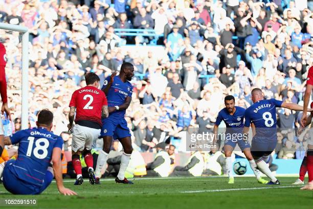 Ross Barkley of Chelsea scores his team's second goal past David De Gea of Manchester United during the Premier League match between Chelsea FC and...