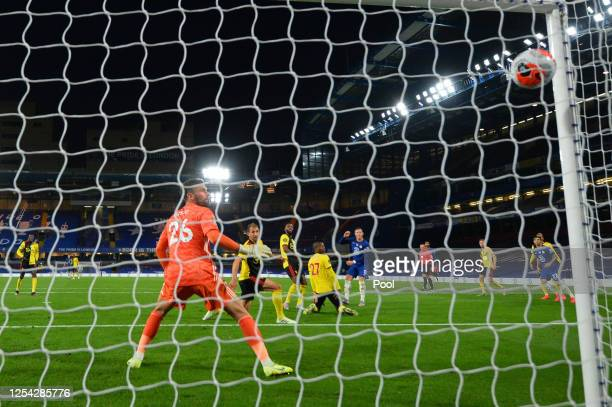 Ross Barkley of Chelsea scores his team's third goal as Ben Foster of Watford reacts during the Premier League match between Chelsea FC and Watford...