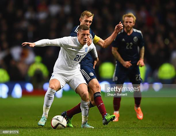Ross Barkley of England and Darren Fletcher of Scotland battle for the ball during the International Friendly between Scotland and England at Celtic...
