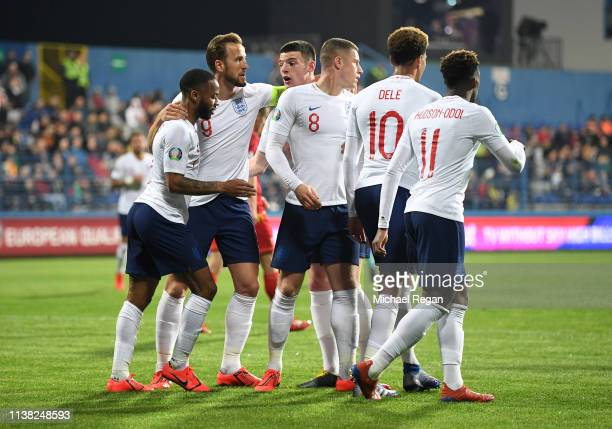 Ross Barkley of England celebrates after scoring his team's third goal with team mates during the 2020 UEFA European Championships Group A qualifying...