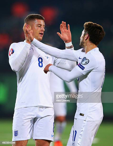 Ross Barkley of England celebrates with Adam Lallana as he scores their first goal during the UEFA EURO 2016 qualifying Group E match between...
