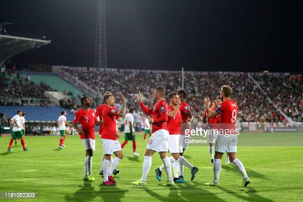 Ross Barkley of England celebrates with team mates after scoring his sides second goal during the UEFA Euro 2020 qualifier between Bulgaria and...