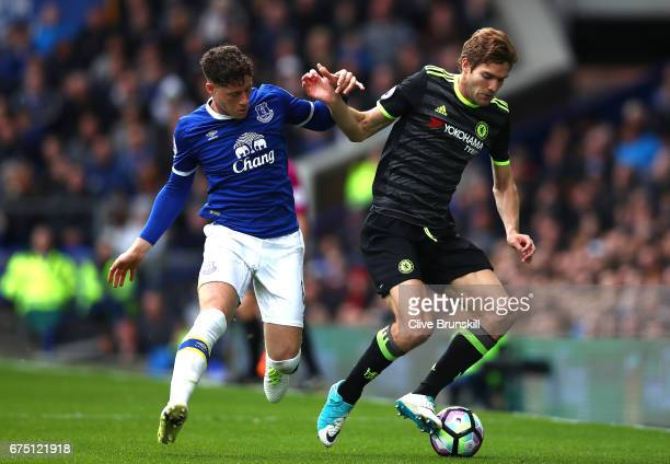 Ross Barkley of Everton and Marcos Alonso of Chelsea battle for possession during the Premier League match between Everton and Chelsea at Goodison...