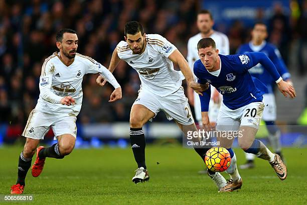 Ross Barkley of Everton battles for the ball with Jordi Amat and Leon Britton of Swansea City during the Barclays Premier League match between...
