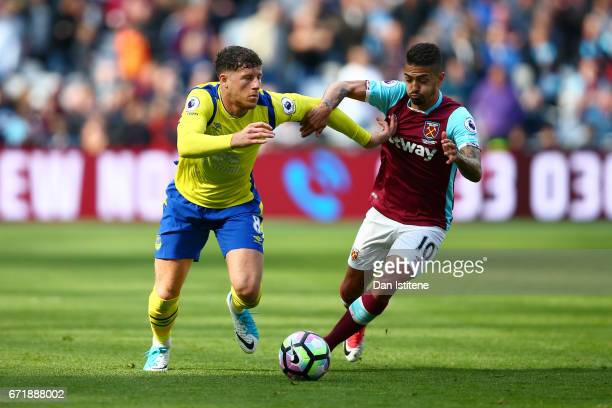 Ross Barkley of Everton battles for the ball with Manuel Lanzini of West Ham United during the Premier League match between West Ham United and...