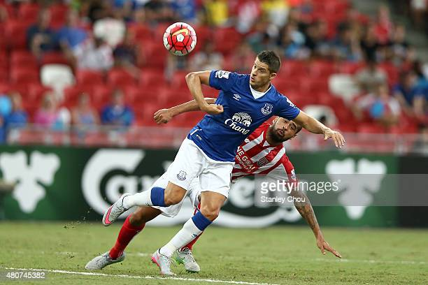 Ross Barkley of Everton battles with Dionatan Teixeira of Stoke City during the Barclays Asia Trophy match between Everton and Stoke City at National...