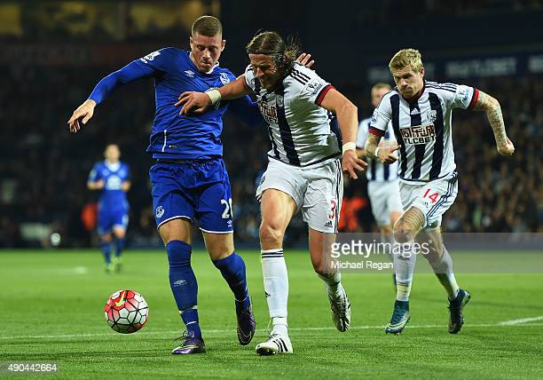 Ross Barkley of Everton battles with Jonas Olsson and James McClean of West Bromwich Albion during the Barclays Premier League match between West...
