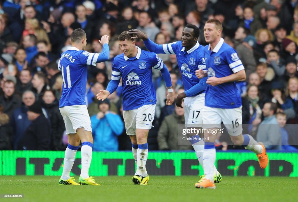 Ross Barkley (2ndL) of Everton celebrates his team's third goal with team mates during the Barclays Premier League match between Everton and Swansea City at Goodison Park on March 22, 2014 in Liverpool, England.