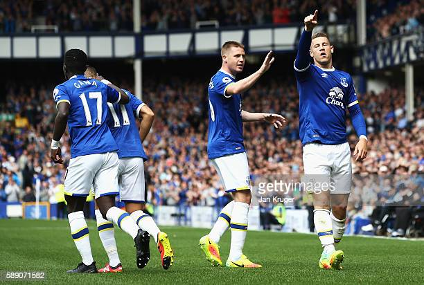 Ross Barkley of Everton celebrates scoring his sides first goal with team mate James McCarthy of Everton during the Premier League match between...