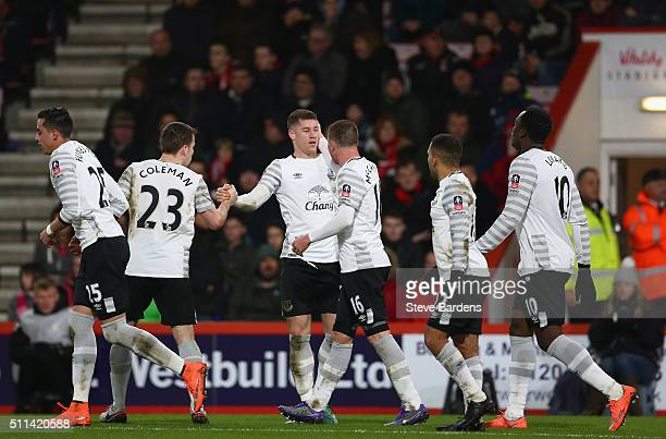 Ross Barkley of Everton celebrates scoring his team's first goal with his team mates during the Emirates FA Cup fifth round match between AFC...