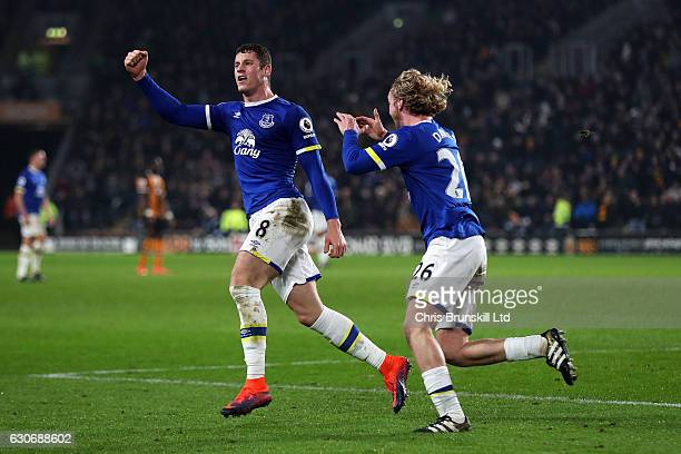 Ross Barkley of Everton celebrates scoring his team's second goal to make the score 2-2 with Tom Davies during the Premier League match between Hull...